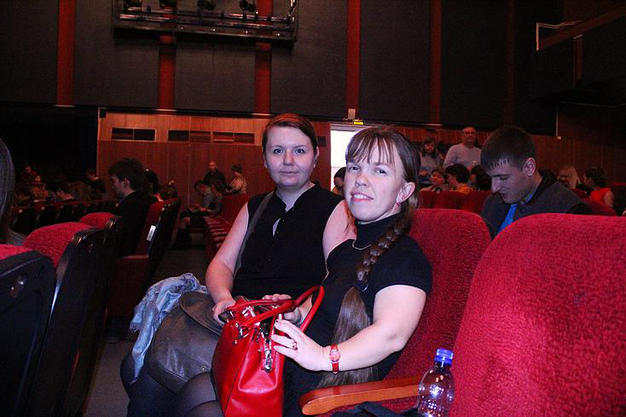 Olya in the theater with her friend