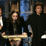 Members of the band Black Sabbath react after being inducted into the Rock and Roll Hall of Fame in New York